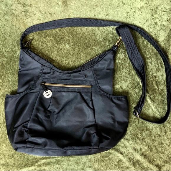 Travelon Handbags - 😂Travelon vinyl shoulder bag